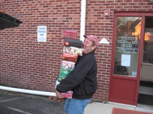 Santa's Helper (Manny Nowak) loads the sleigh (their van) with Christmas shoe boxes filled with things for kids in preparation for taking them to the Samaritan's Purse regional drop off point in Vineland for their Operation Christmas Child program.